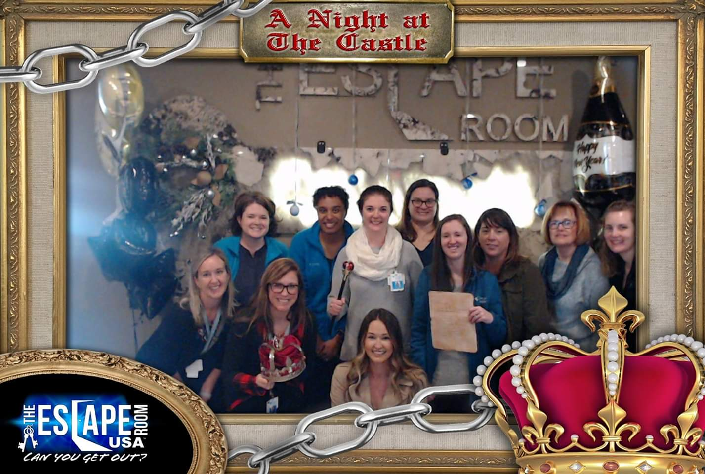 Two rows of 9 of Indiana's Premier Hospice and Palliative care Social Worker's participating in a fun team building activity at the Escape Rooms and posing for a photo for successfully escaping with minutes to spare!
