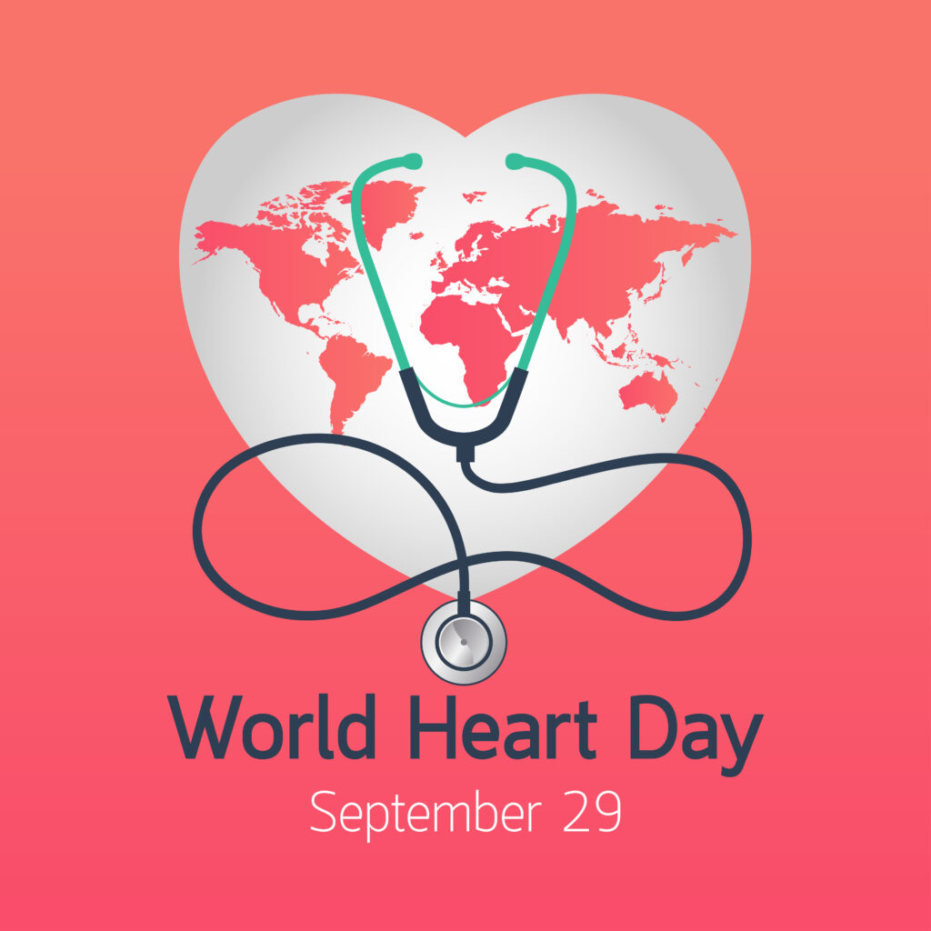 Light gray heart with pink world map inside. Stethoscope over the heart. Text that reads World Heart Day September 29.